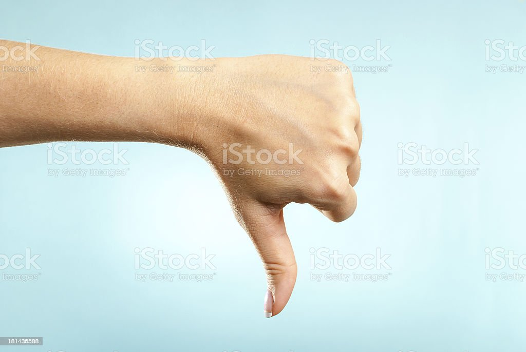 Human hand making dislike dissatisfaction bad disagreement discontent gesture stock photo