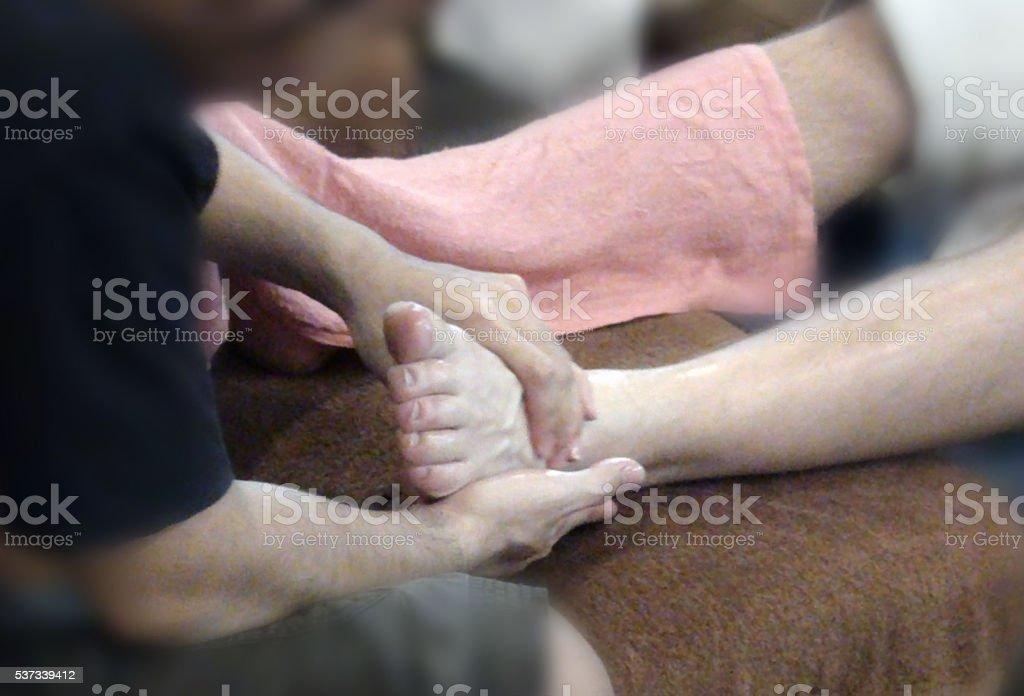 Human Hand Massaging Human Foot stock photo