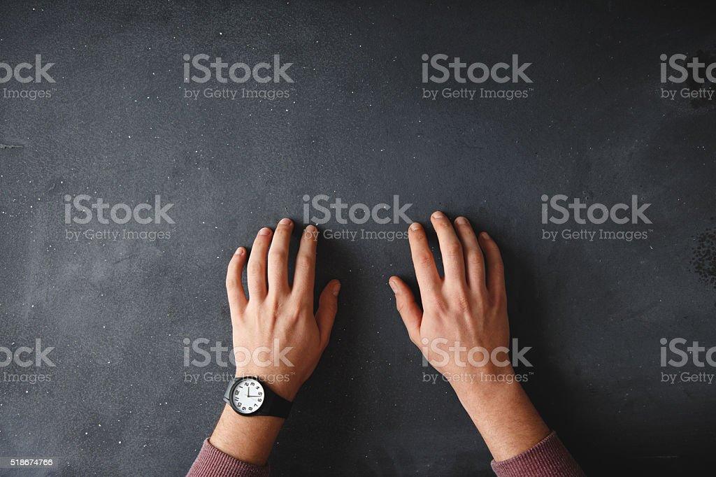 Human hand on black desk stock photo