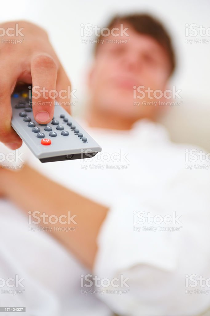 Human hand operating remote control royalty-free stock photo