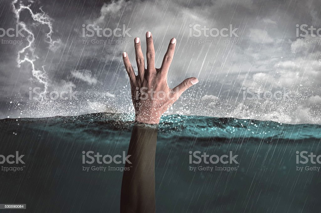 Human hand out from water stock photo