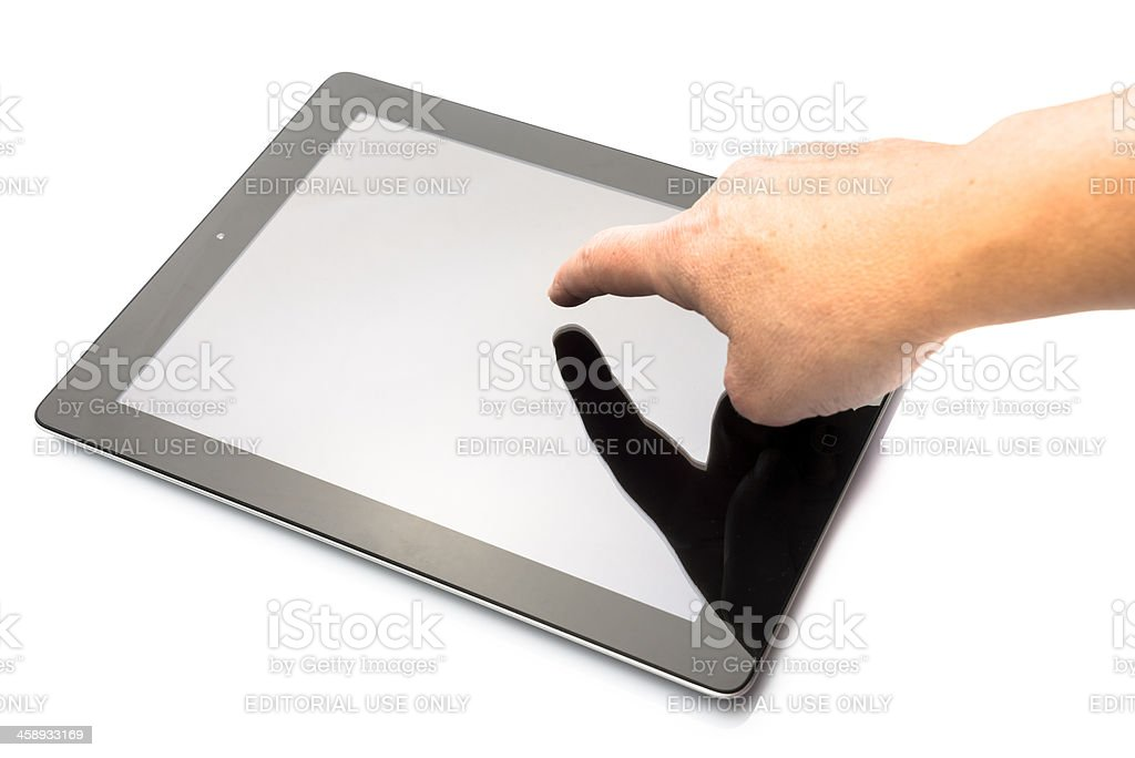Human hand scrolling the new ipad 3 royalty-free stock photo