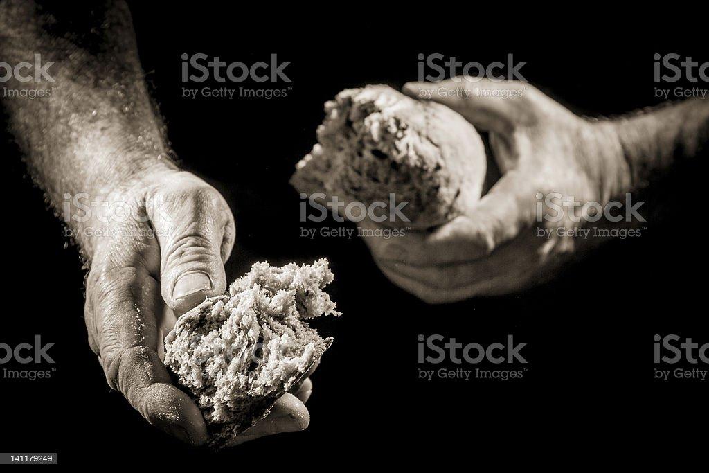 Human hand sharing food stock photo