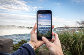 Human Hand Taking Picture at Niagara Falls with Smart phone