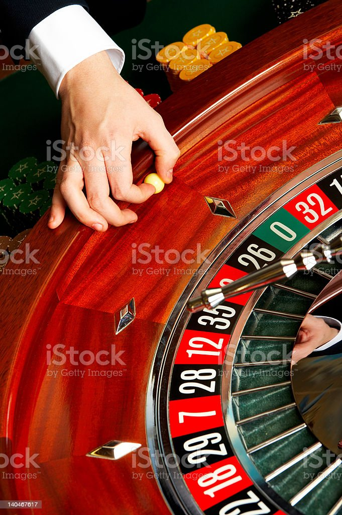 Human hand throwing ball in roulette wheel royalty-free stock photo