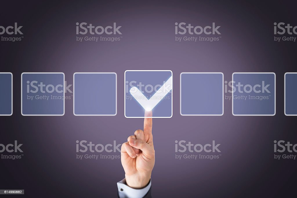 Human Hand Touching Checklist on Touch Screen stock photo