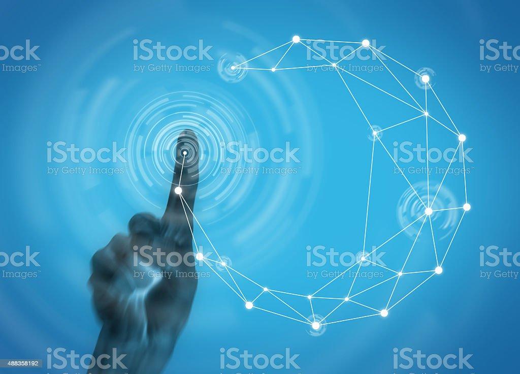 Human hand touching futuristic button to display network communication stock photo