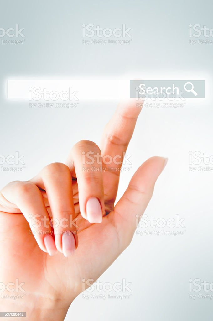 Human hand touching search button stock photo