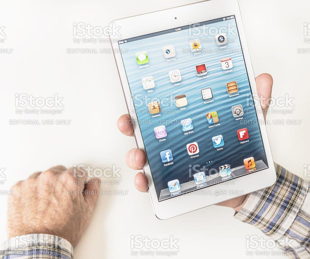 Human hand touching the mail icon on Ipad Mini stock photo