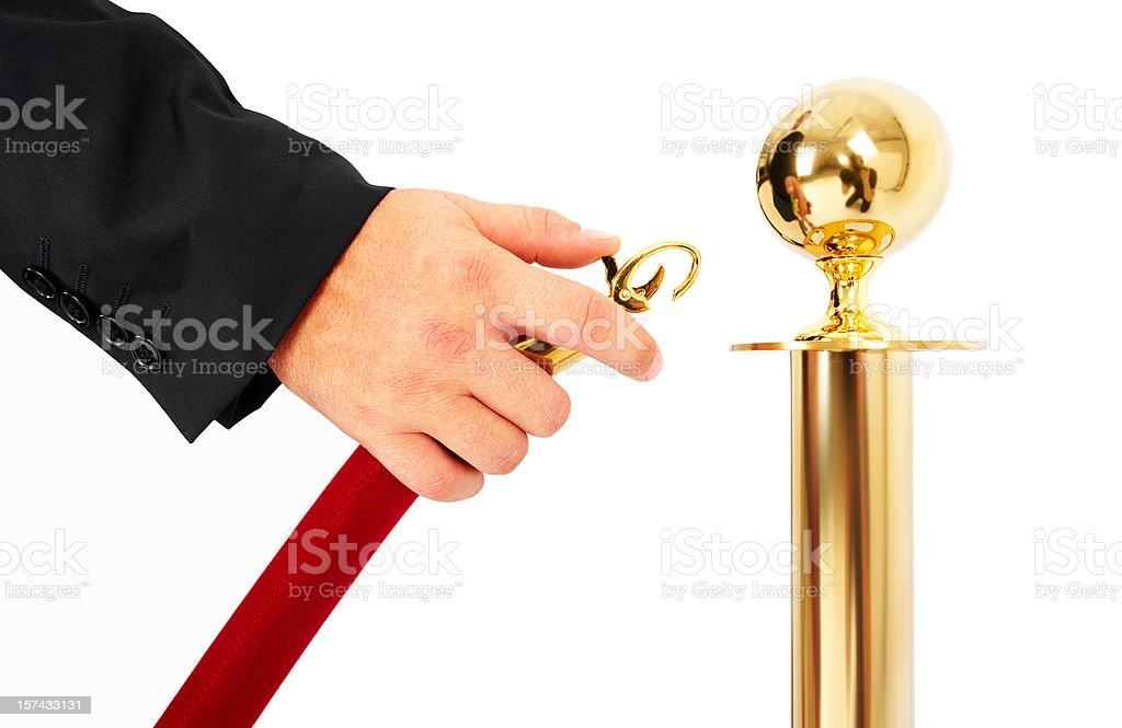 Human hand unlocking a queue barrier on white stock photo