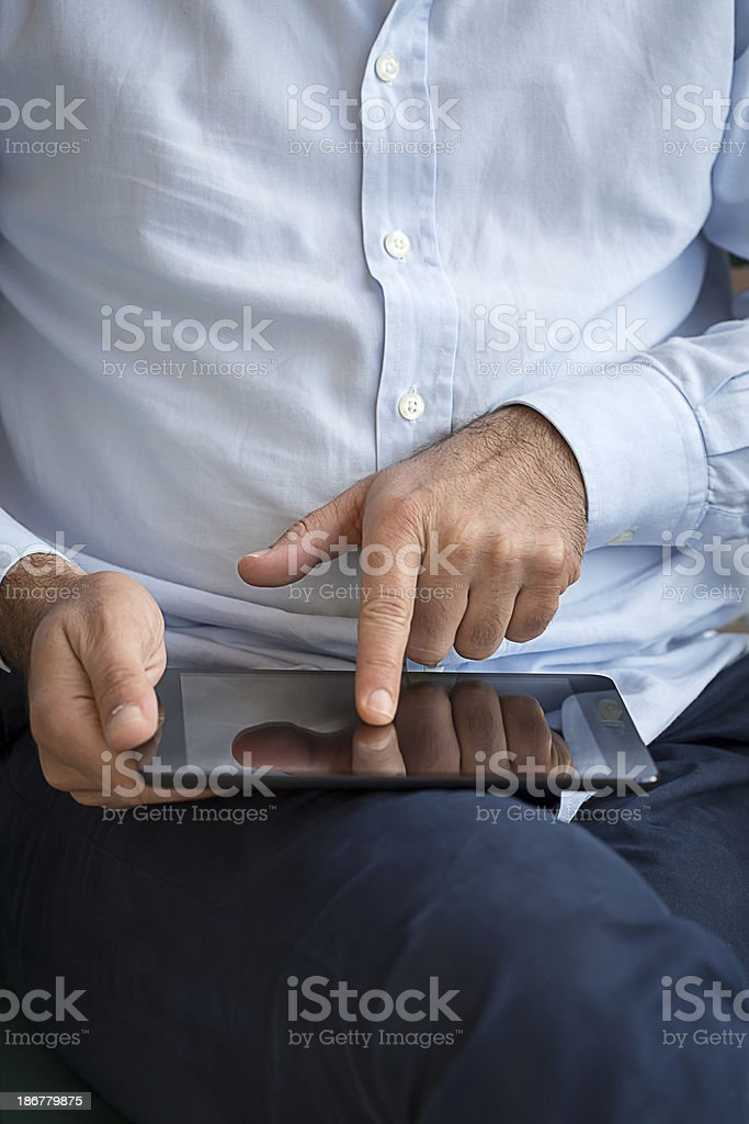 Human hand using tablet royalty-free stock photo