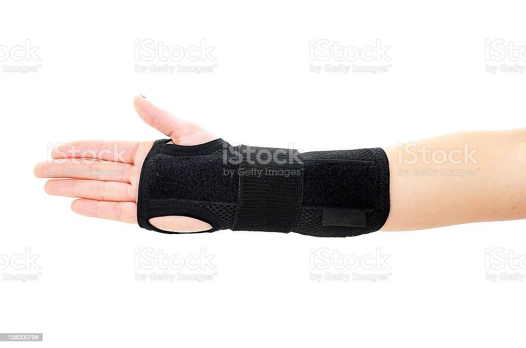 Human hand with a wrist brace, orthopeadic equipment stock photo