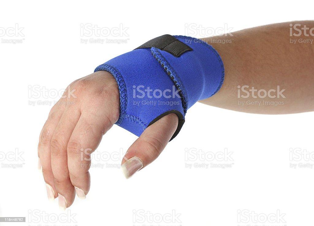 Human hand with a wrist brace royalty-free stock photo