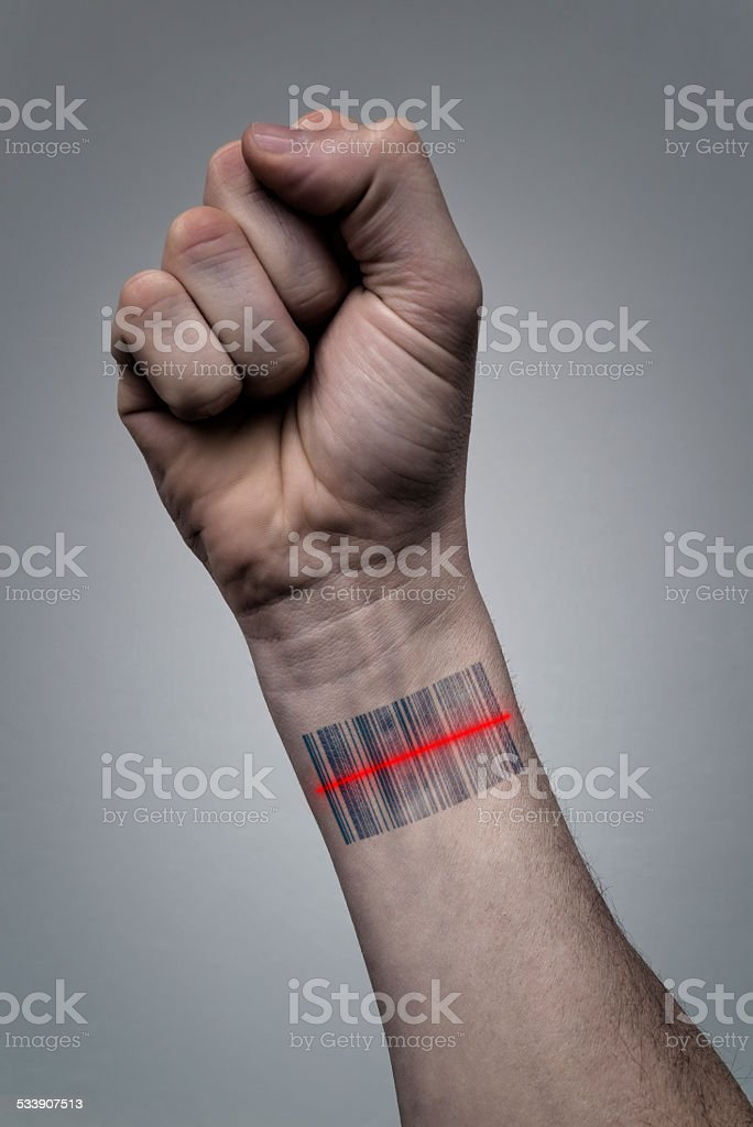 human hand with barcode scan stock photo