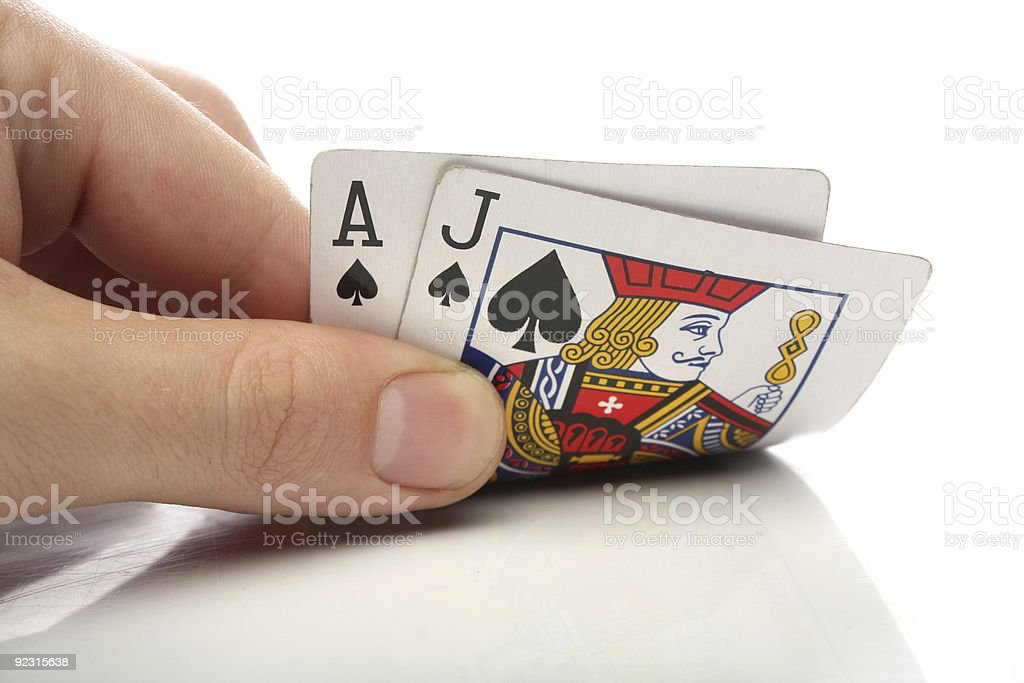 Human hand with blackjack cards over white stock photo