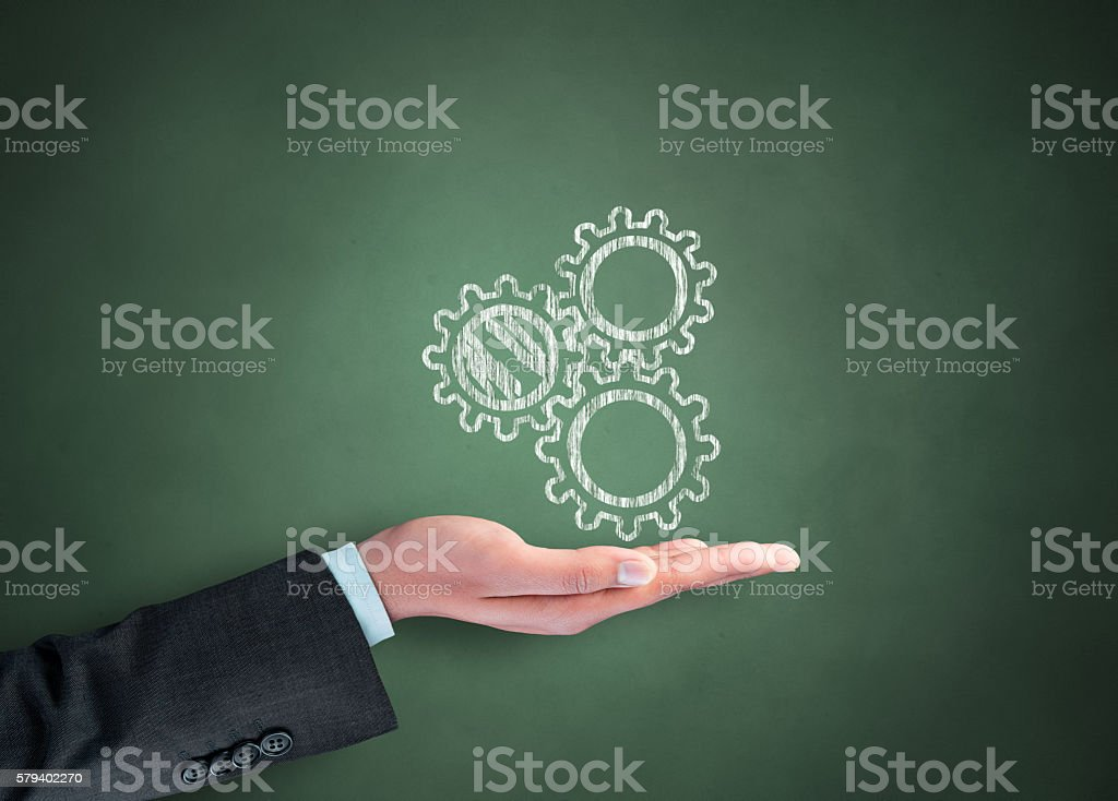 Human hand with gears stock photo