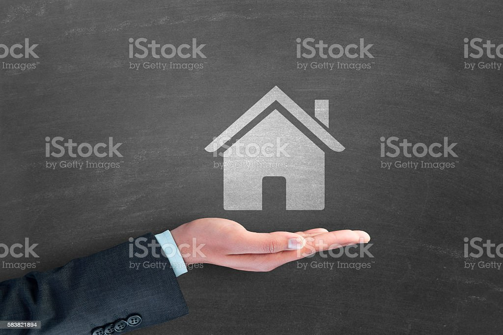 Human hand with model home stock photo