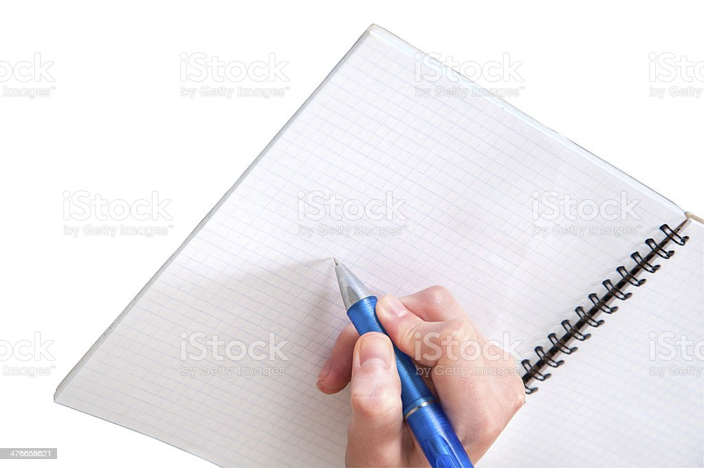 Human hand writes on exercise book royalty-free stock photo