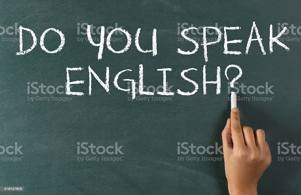Human Hand Writing 'Do You Speak English' stock photo