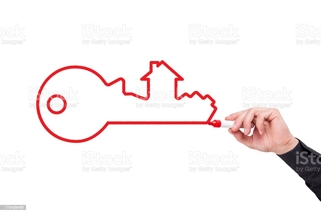 Human Hand Writing House Key Concept&Mortgage on Whiteboard royalty-free stock photo