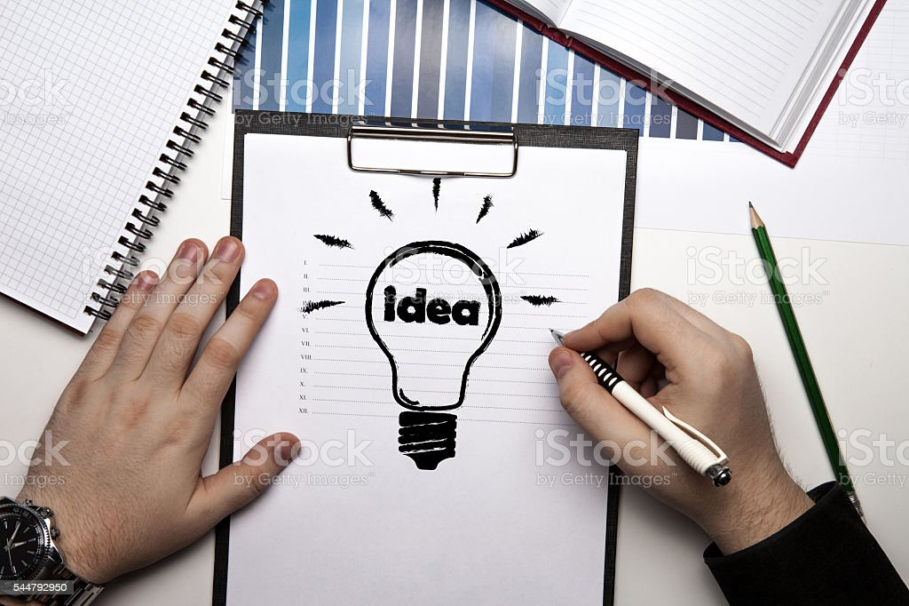 human hands and idea icon close up stock photo