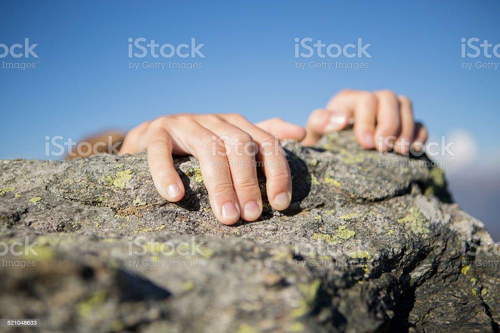 Human hands climbing mountain stock photo
