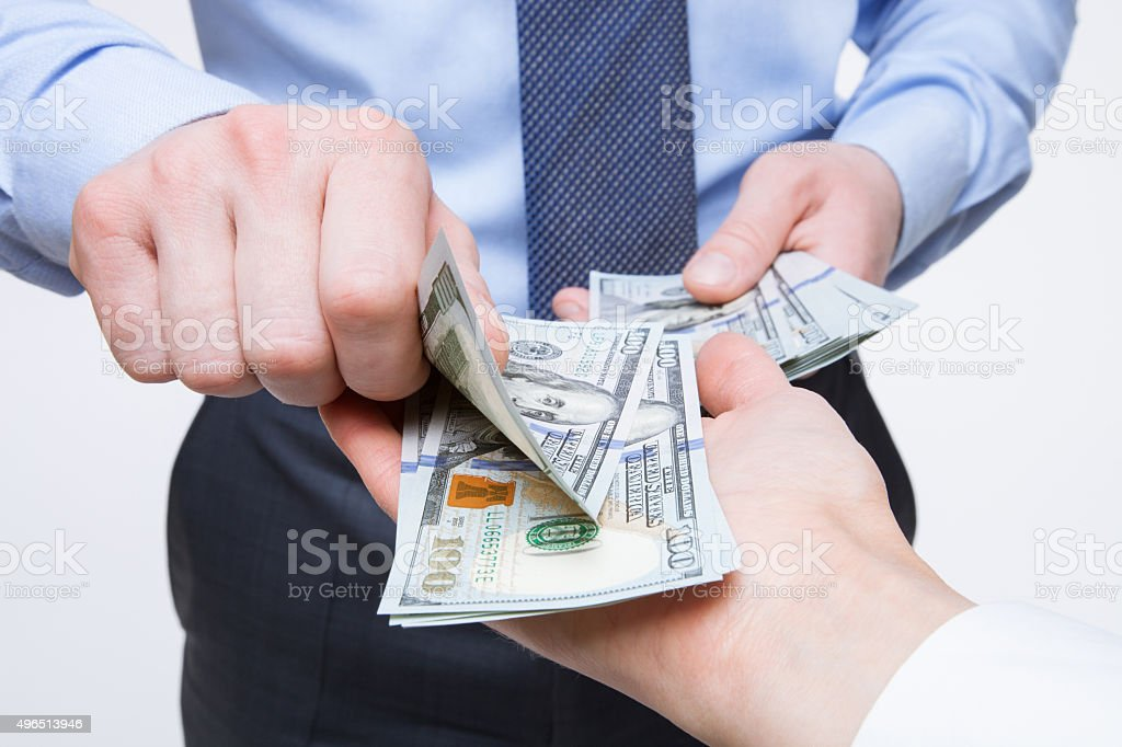 Human hands exchanging money stock photo