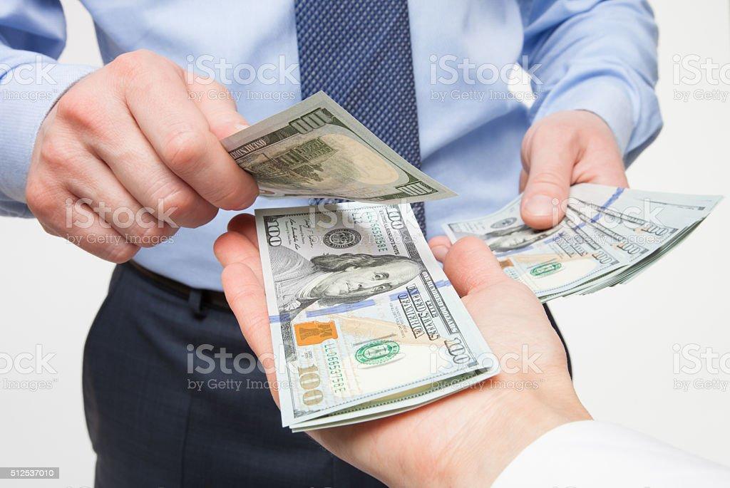 Human hands exchanging money stock photo