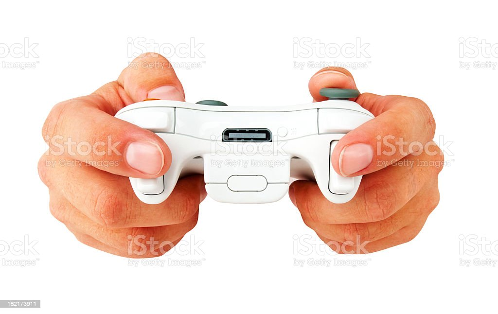 Human hands holding a wireless gaming controller on white background stock photo