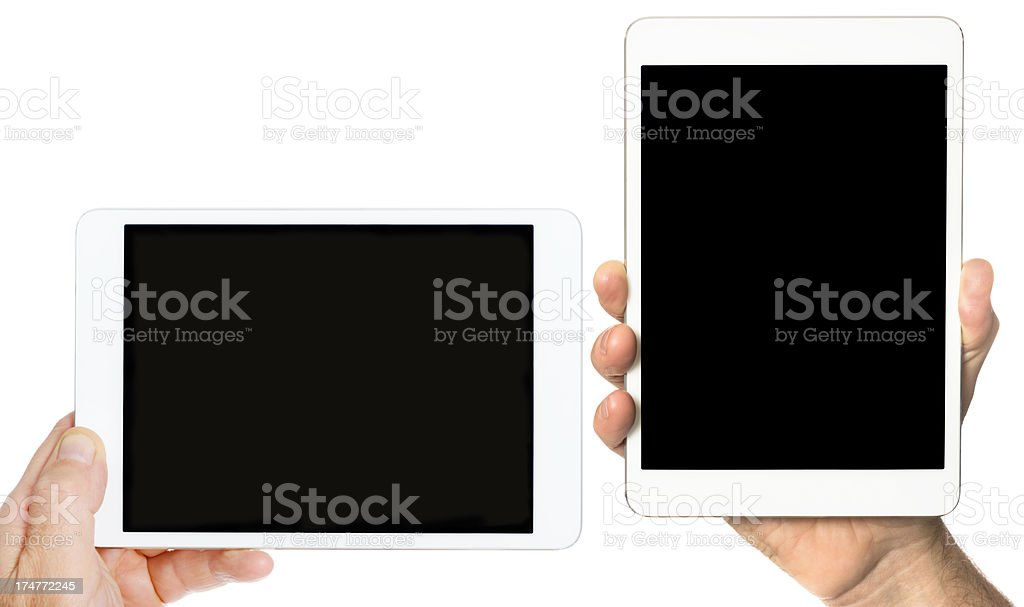 Human hands holding two contemporary digital tablet royalty-free stock photo