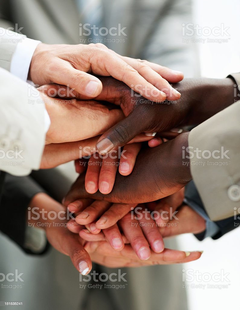 Human hands on top of each other stock photo