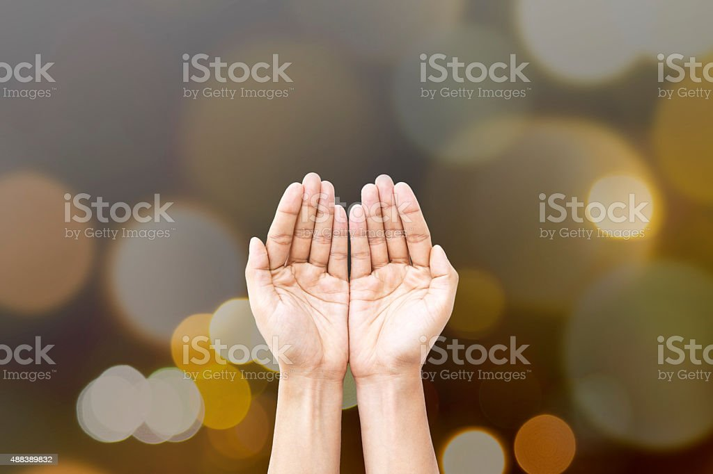 Human hands open palm for giving, help and praying. stock photo