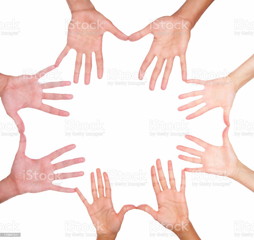 Human hands placed in a circle over a white background stock photo