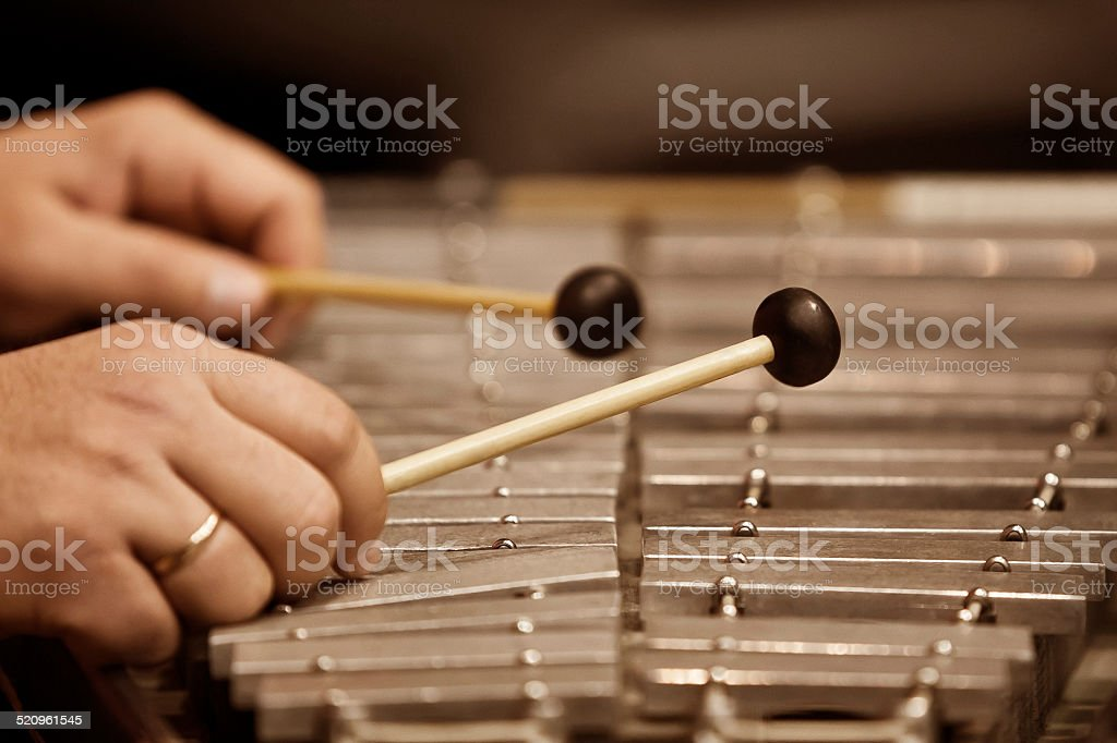 Human hands playing a glockenspiel stock photo