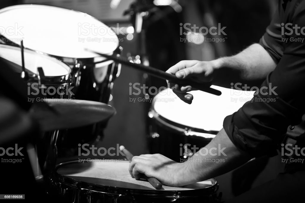 Human hands playing the drum kit stock photo