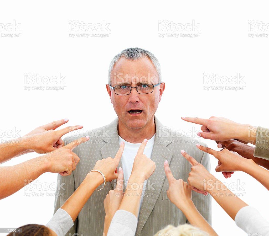 Human hands pointing towards senior businessman stock photo