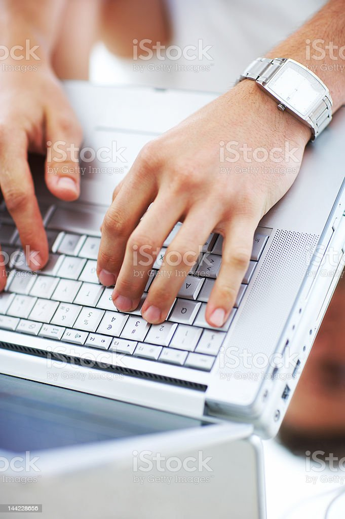Human hands typing on a laptop royalty-free stock photo