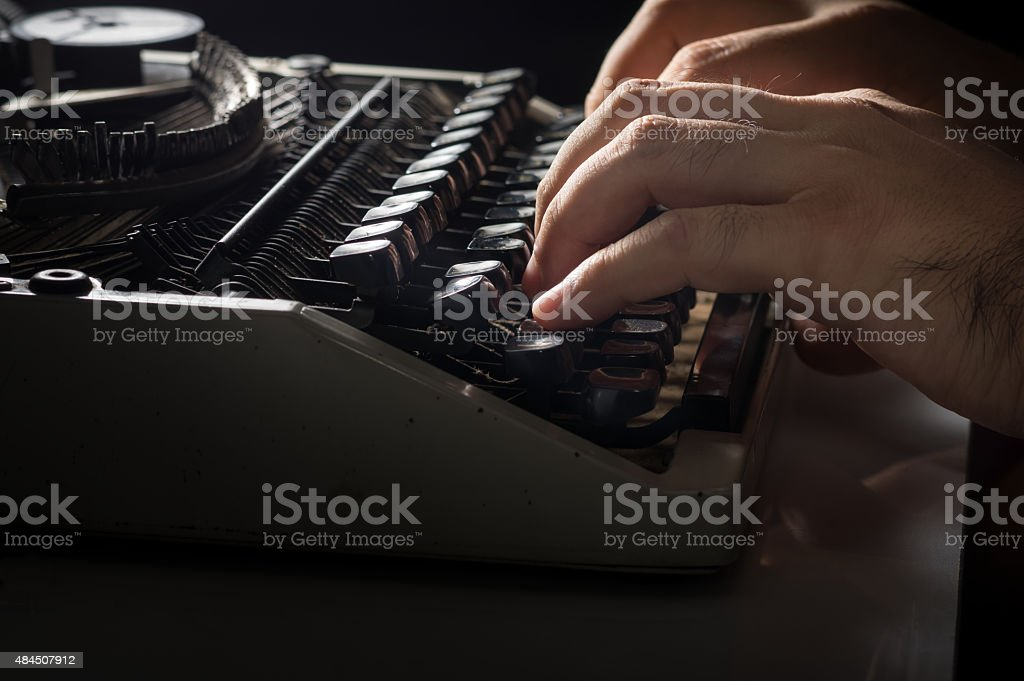 Human hands typing with typewriter stock photo