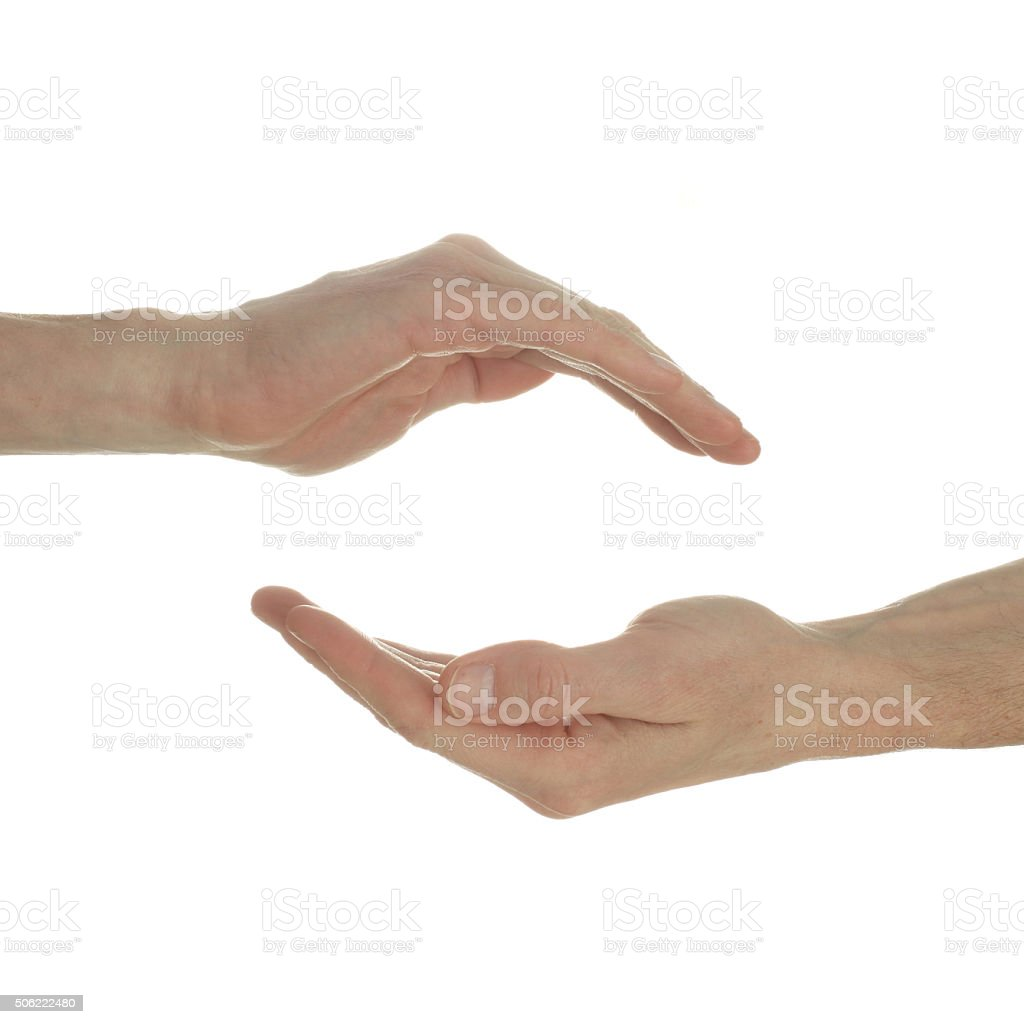Human hands with protecting gesture on white stock photo