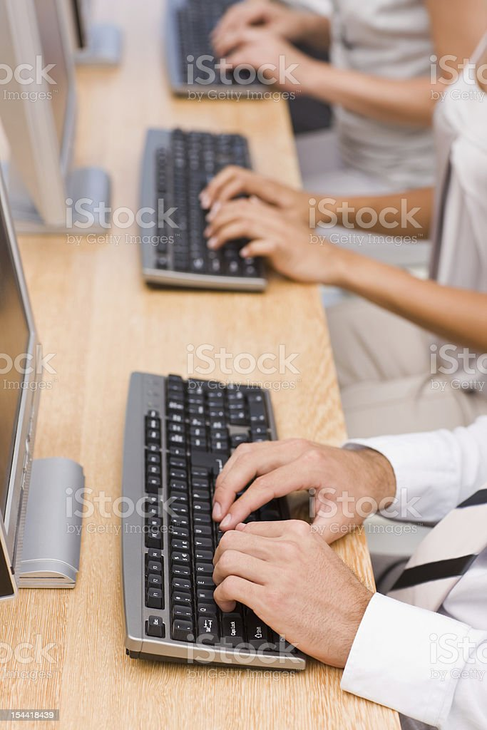 Human hands working on computer in office royalty-free stock photo