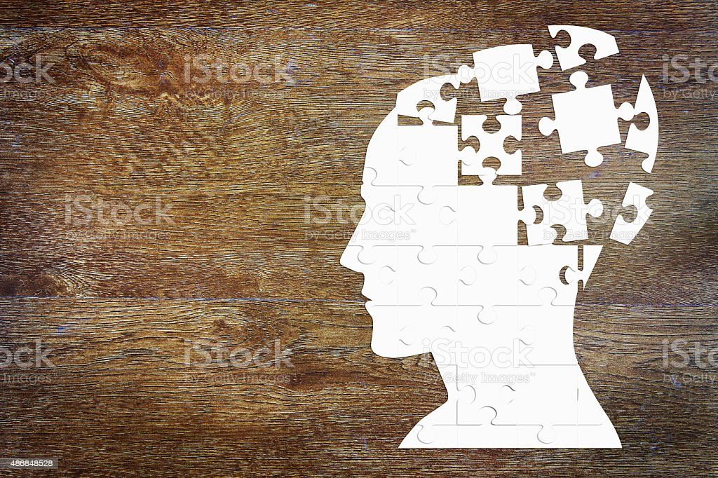 Human head as a set of puzzles stock photo