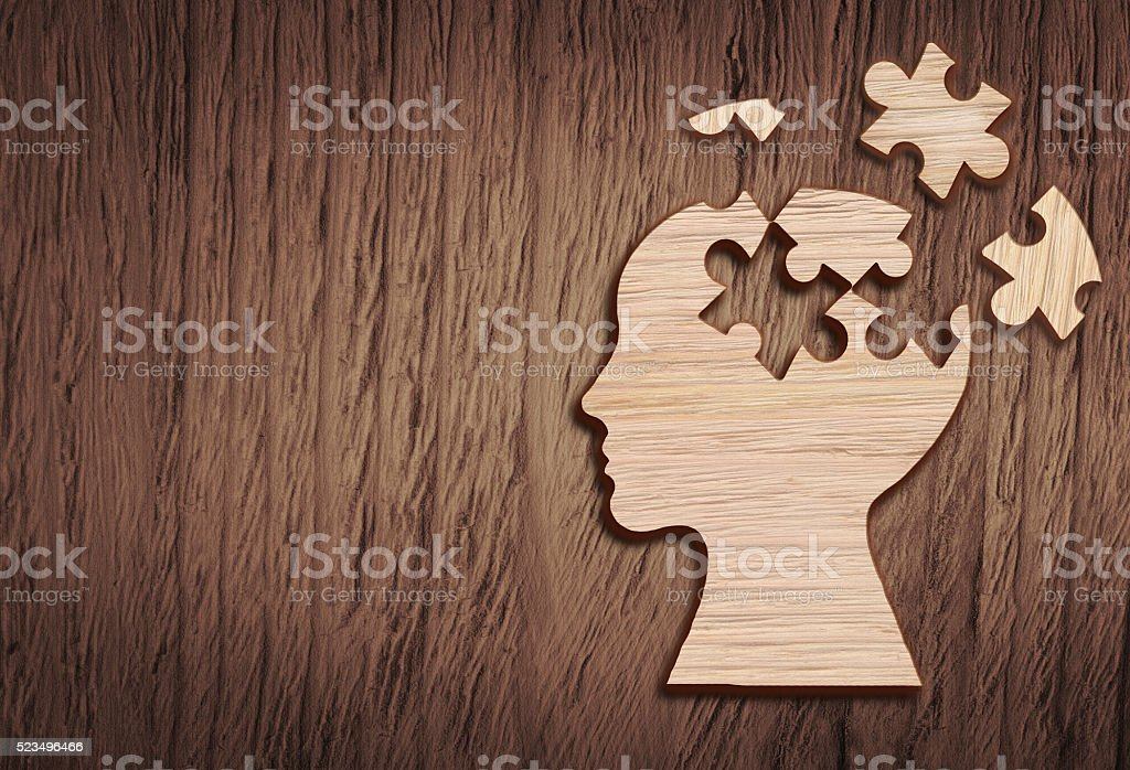Human head silhouette with a jigsaw piece cut out stock photo