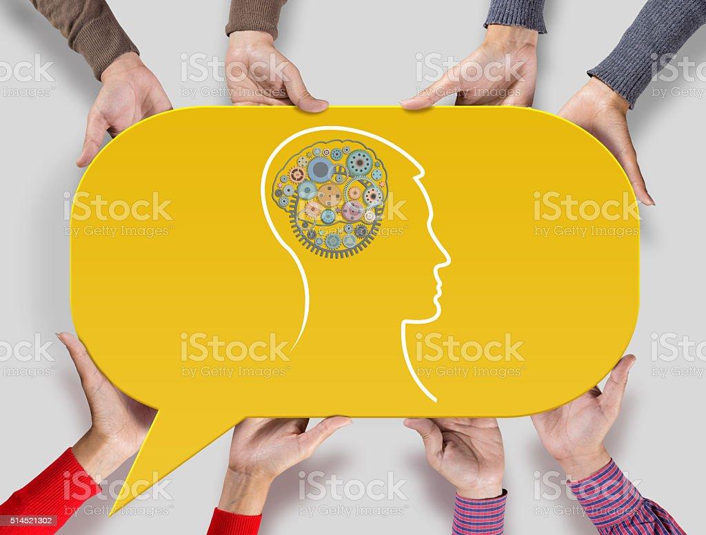 Human head with gears on yellow speech bubble stock photo