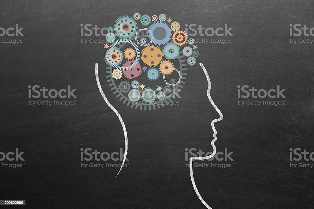 Human head with gears stock photo