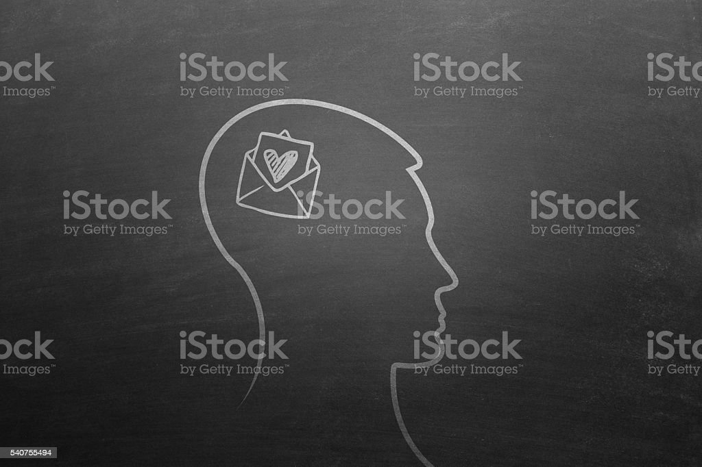 Human head with heart shaped envelop stock photo