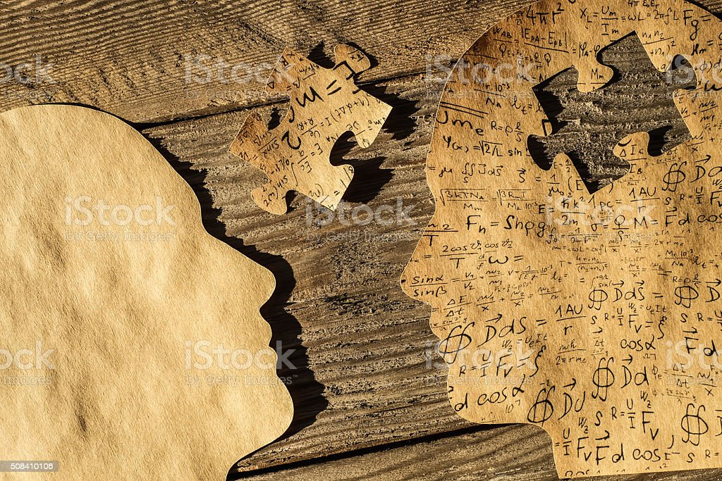 Human Heads with Puzzle part stock photo