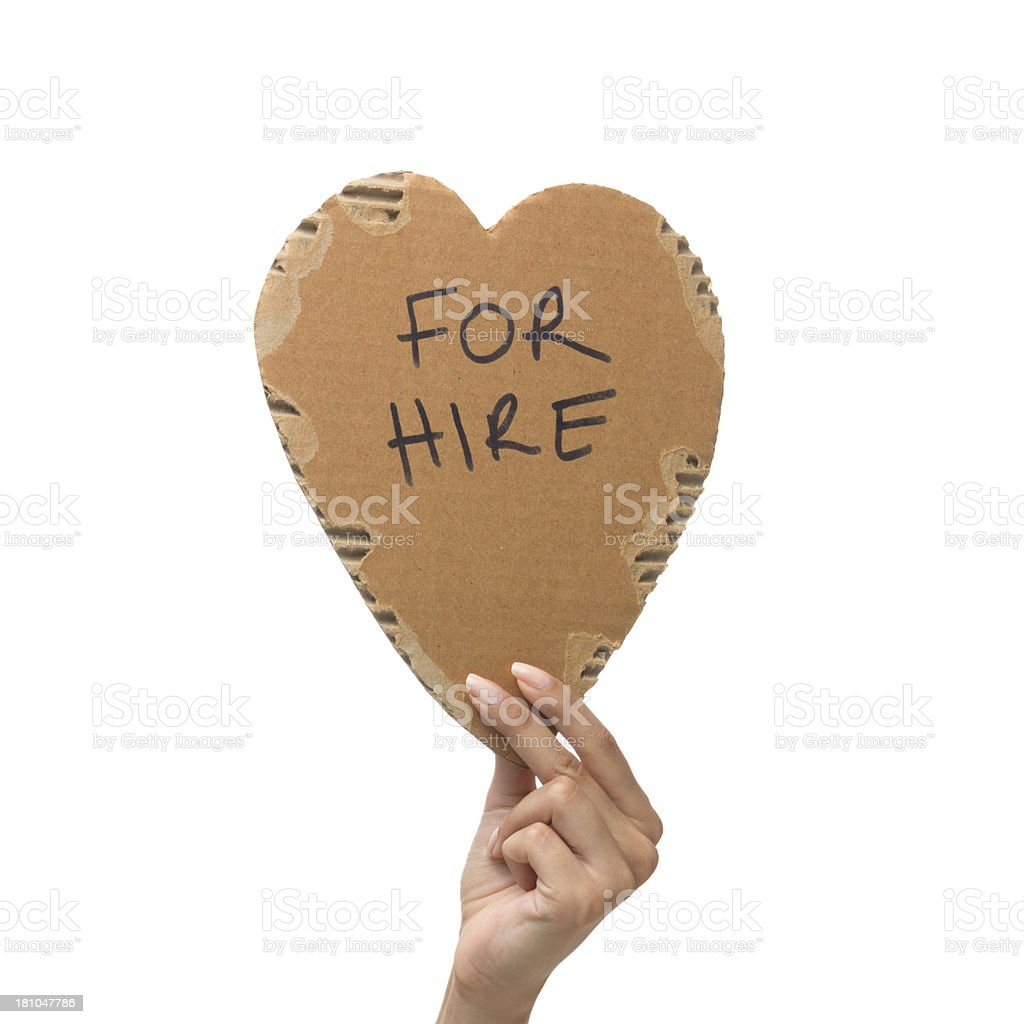 Human heart for hire in woman hand royalty-free stock photo