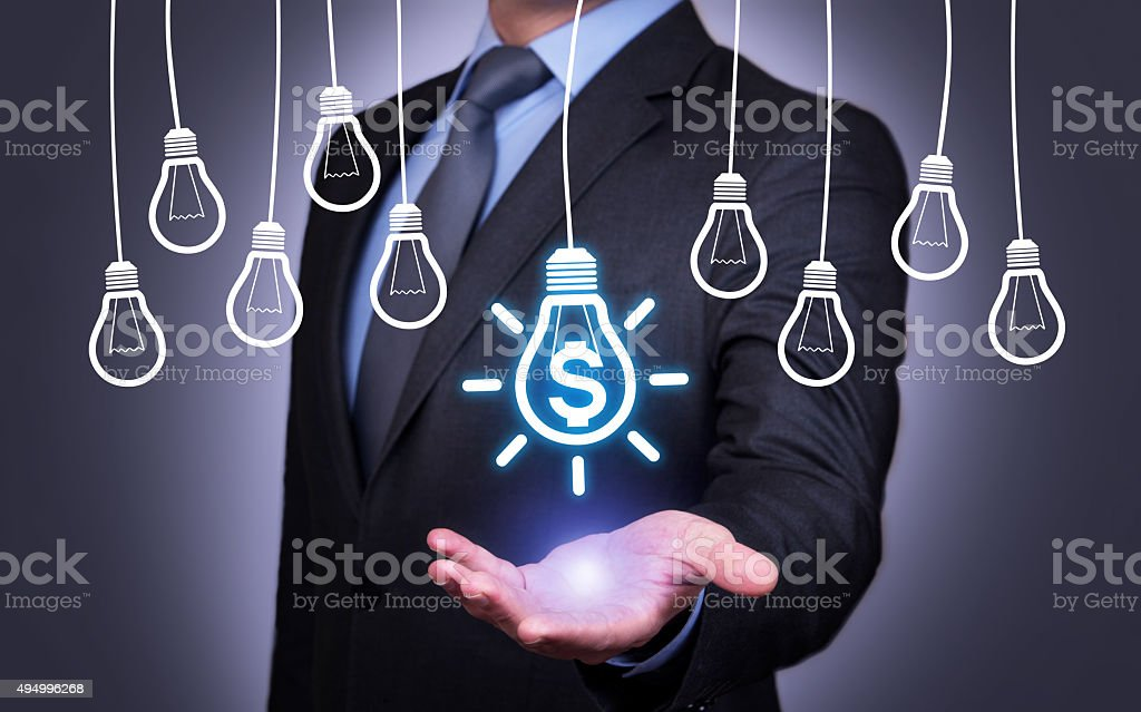 Human Holding his Hand Above the Finance Idea Bulb stock photo