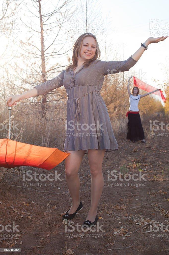 Human in Nature: Orange Umbrella-individualism stock photo