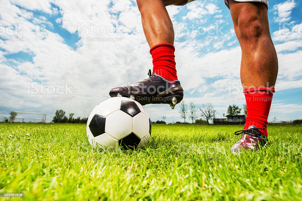 Human leg on a soccer ball. stock photo